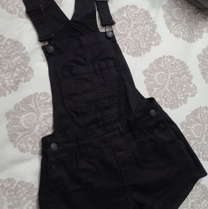 Black jean overalls in size 22.